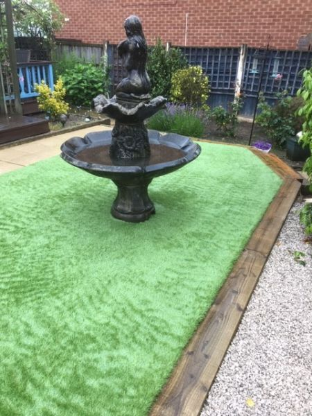 Astro Turf (artificial grass) with sleeper boarders and a water feature, Nottingham: Swipe To View More Images