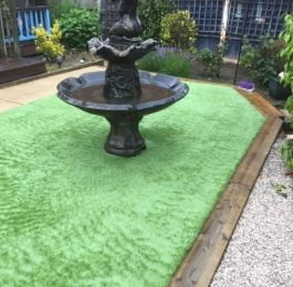 Astro Turf (artificial grass) with sleeper boarders and a water feature, Nottingham: Click Here To View Larger Image